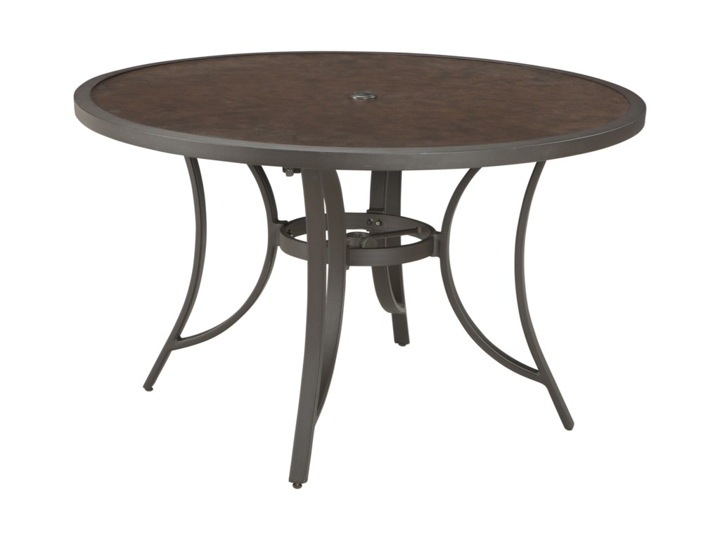 Outdoor round dining table - Signature Design By Ashley Carmadelia Outdoor Round Dining Table W Umbrella Option John V Schultz Furniture Outdoor Dining Table