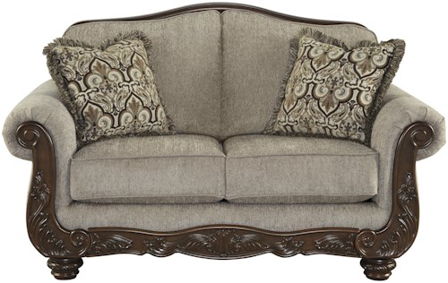 Signature Design by Ashley Cecilyn Traditional Loveseat with Showood Trim & Camel Back