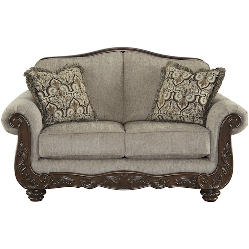 Signature Design by Ashley Cedric Traditional Loveseat with Showood Trim & Camel Back