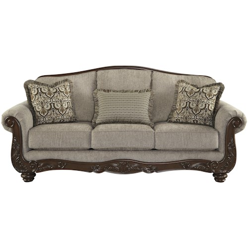 Signature Design by Ashley Cedric Traditional Sofa with Showood Trim & Camel Back