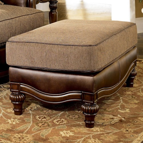 Signature Design by Ashley Claremore - Antique Traditional Two-Toned Ottoman with Scalloped Base