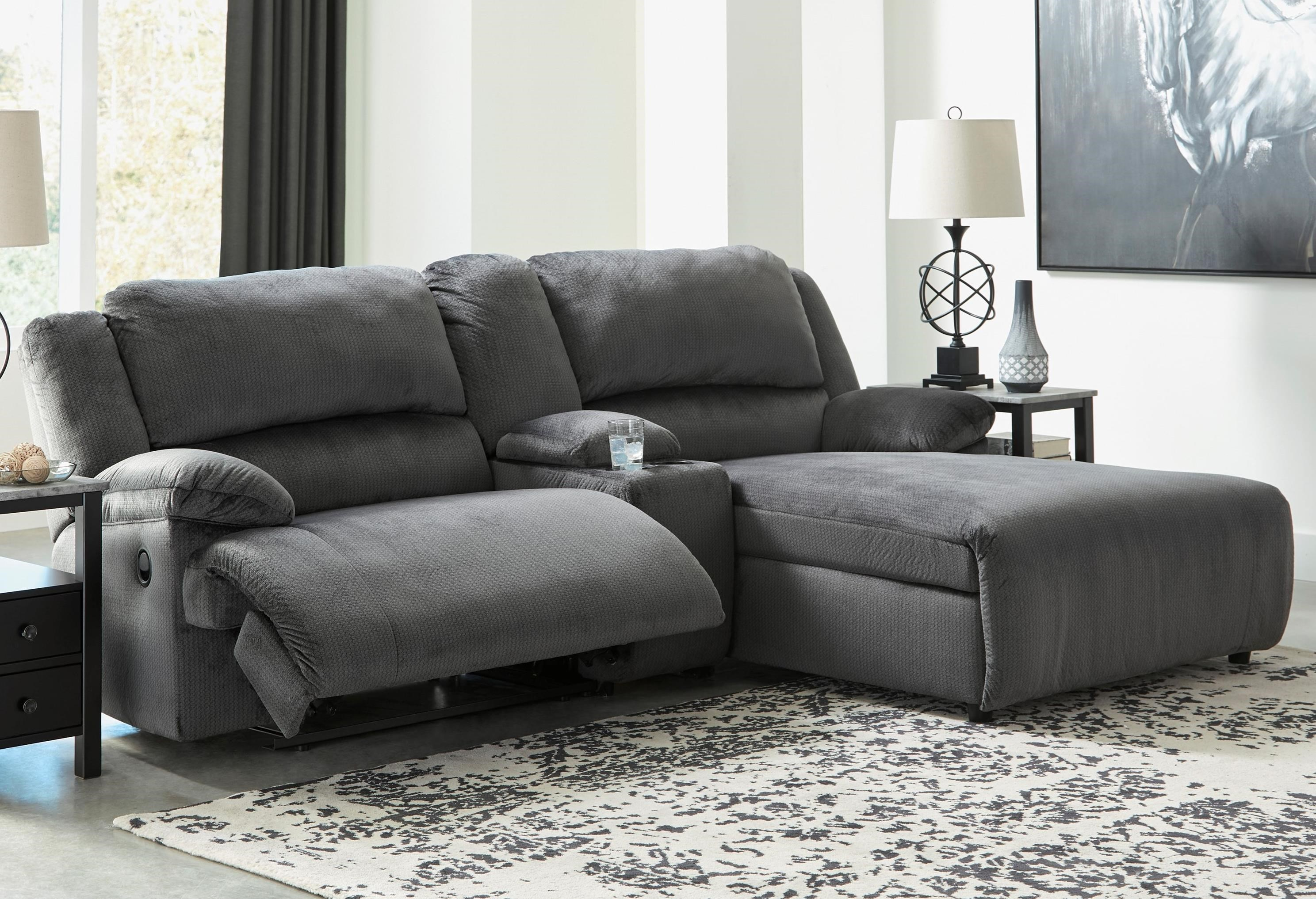 Picture of: Signature Design By Ashley Clonmel Reclining Sectional W Chaise Console Royal Furniture Reclining Sectional Sofas