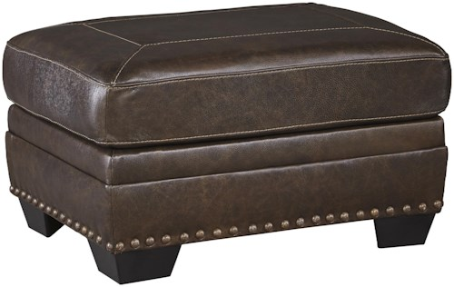 Signature Design by Ashley Corvan Leather Match Ottoman with Nailhead Trim