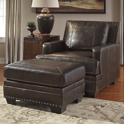Signature Design by Ashley Corvan Leather Match Chair with Coil Seat Cushion & Ottoman