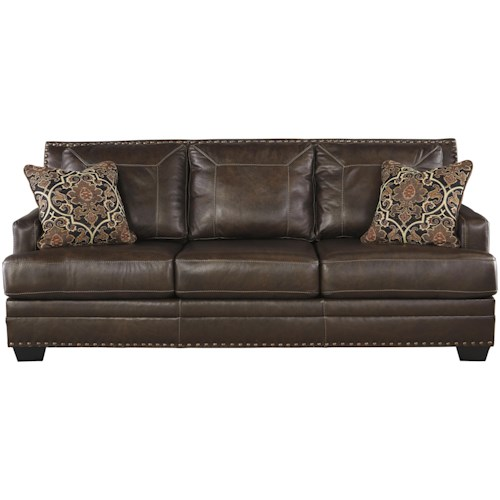 Signature Design by Ashley Corvan Leather Match Sofa with Coil Seat Cushions