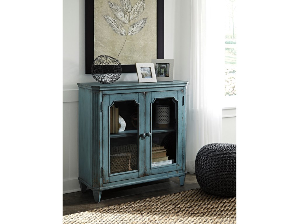 Accent cabinet with glass doors - Signature Design By Ashley Mirimyn French Provincial Style Glass Door Accent Cabinet In Antique Teal Finish Del Sol Furniture Accent Chests