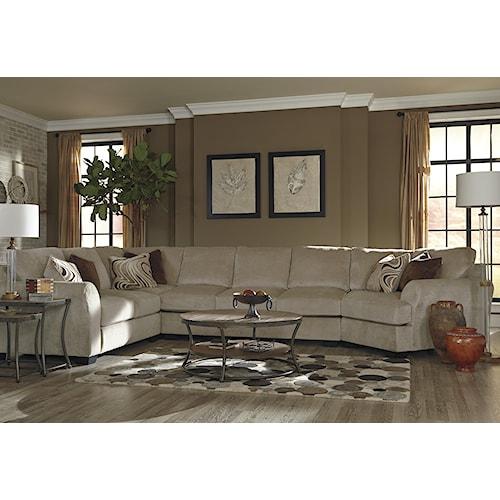 Benchcraft by Ashley Hazes 4-Piece Sectional w/ Armless Sofa & Right Cuddler
