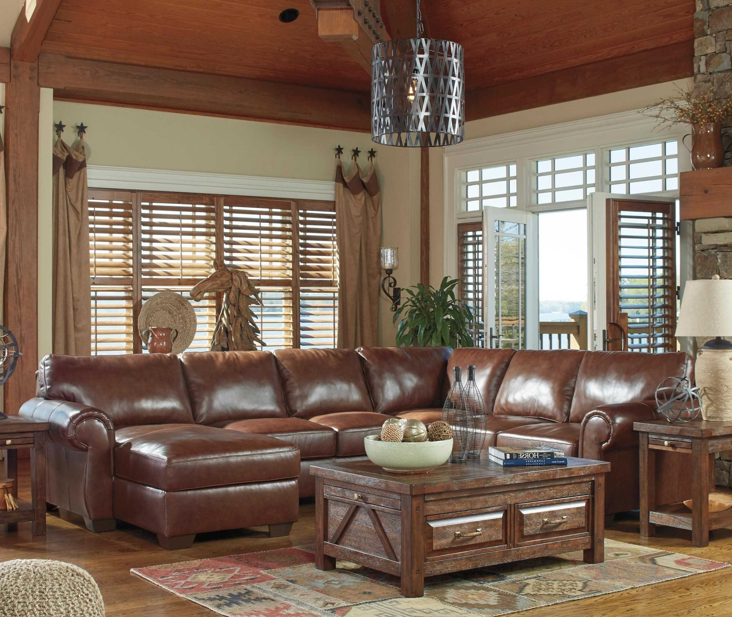 Signature Design By Ashley Lugoro Leather Match 4 Piece Sectional With Left  Chaise