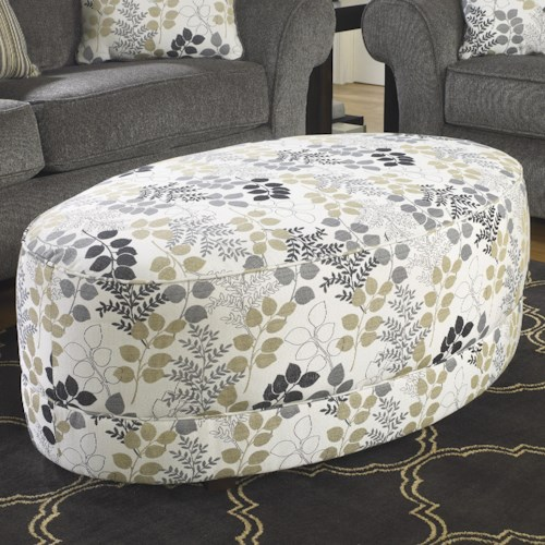 Signature Design by Ashley Makonnen Oval Oversized Accent Ottoman with Leafy Print