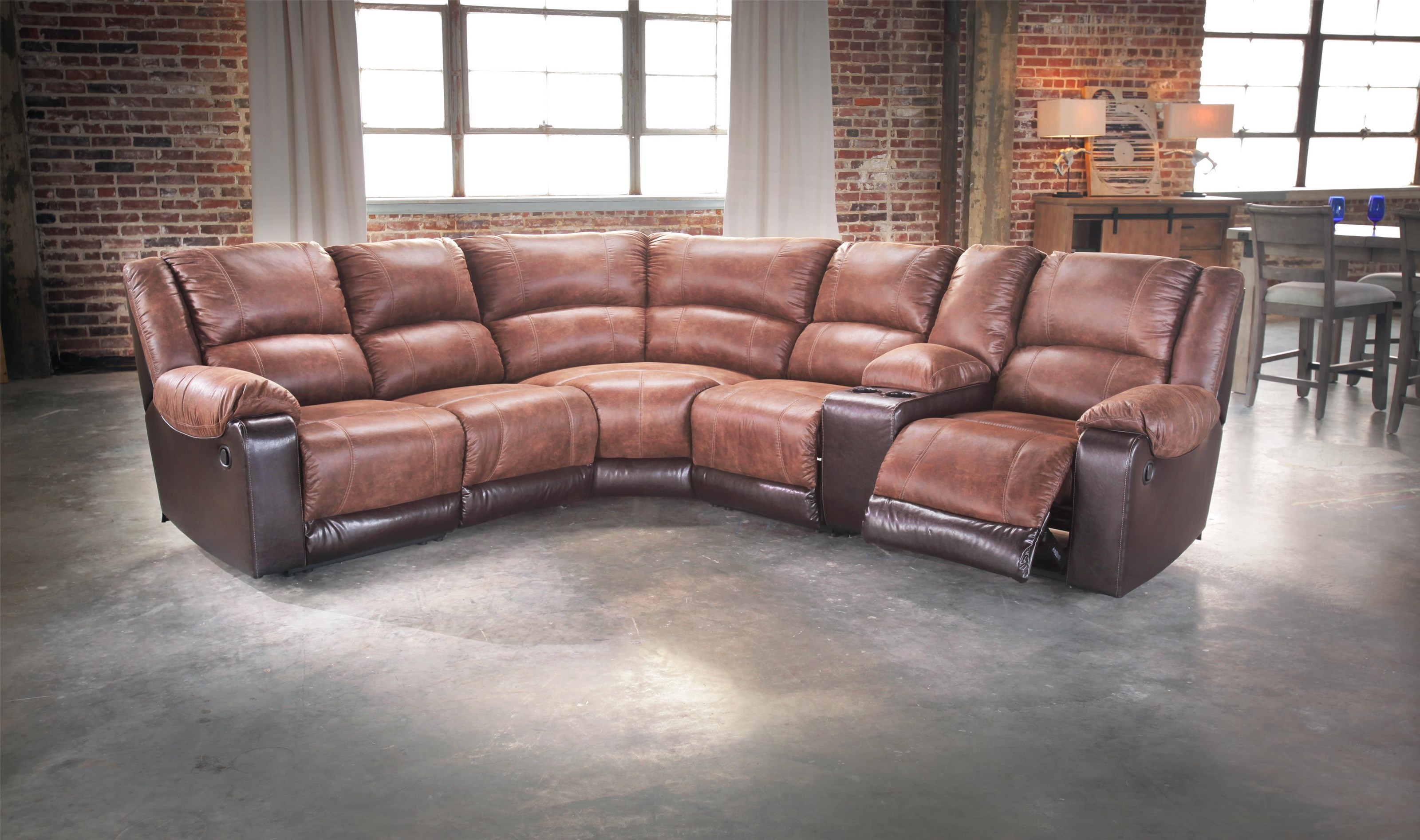 signature design by ashley nantahala faux leather reclining sectional with console u0026 3 recliners royal furniture reclining sectional sofas