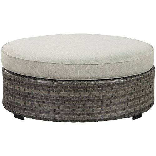 Signature Design by Ashley Spring Dew Resin Ottoman with Cushion