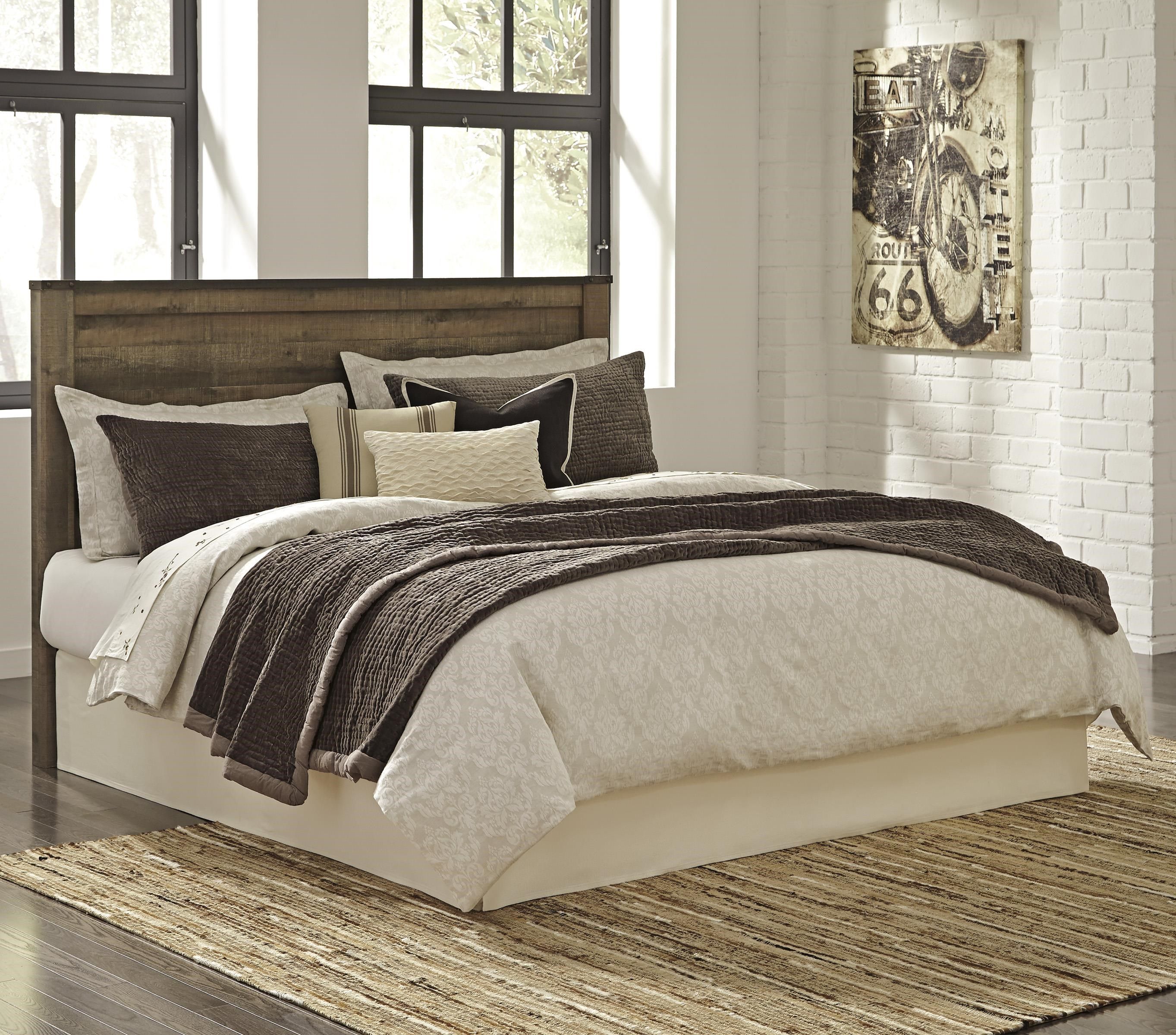 signature design by ashley trinell rustic look kingcal king panel headboard with metal brackets