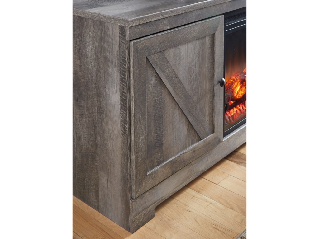 Signature Design by Ashley WynnlowLarge TV Stand with Fireplace