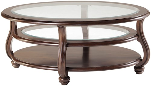 Signature Design by Ashley Yexenburg Oval Cocktail Table with Tempered Glass Top