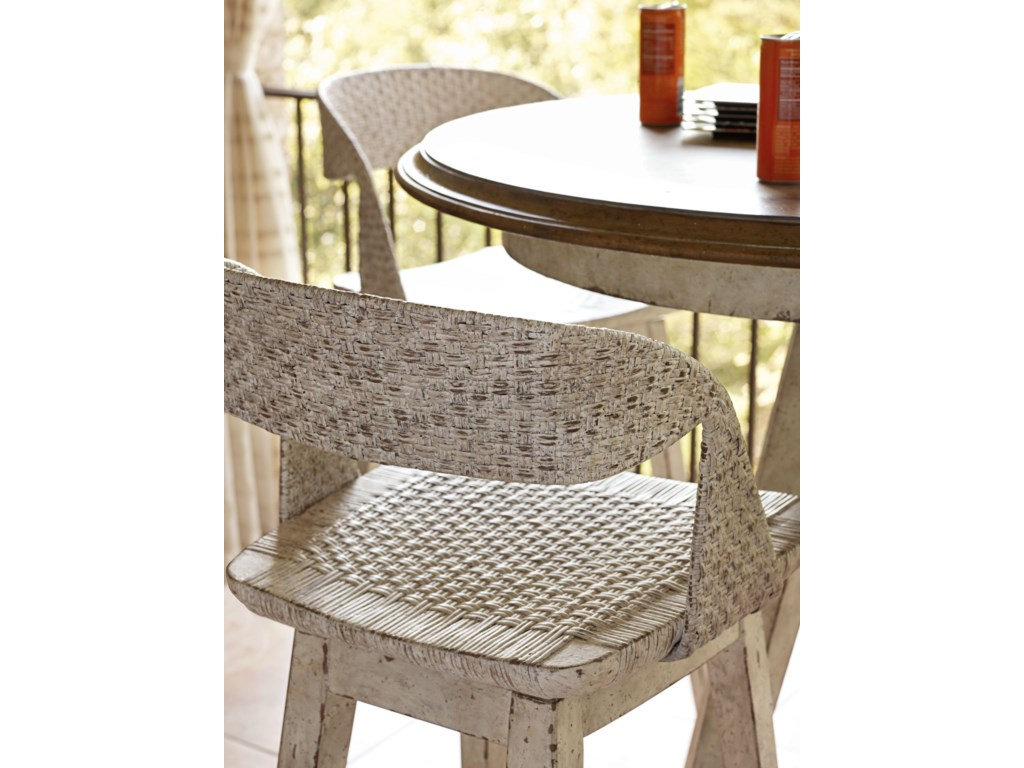 Woven cane lends texture and dimension on the backs and seats of the Tambu Stool.