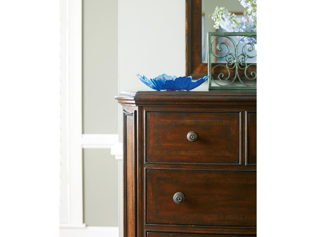 Cross-grain quartered walnut inlays in the drawer fronts add visual texture and dimension to the Dresser.