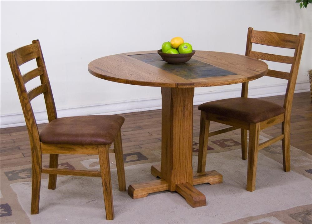 Shown as table set with upholstered ladderback chairs