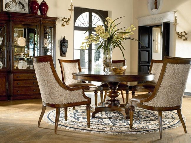 Rift Valley Dining Table Shown in Room Setting with Marceliano Arm Chairs and Green Hills China
