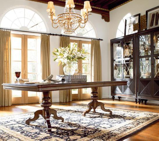 Castillian Double Pedestal Table Shown with Masai Curio Chinas