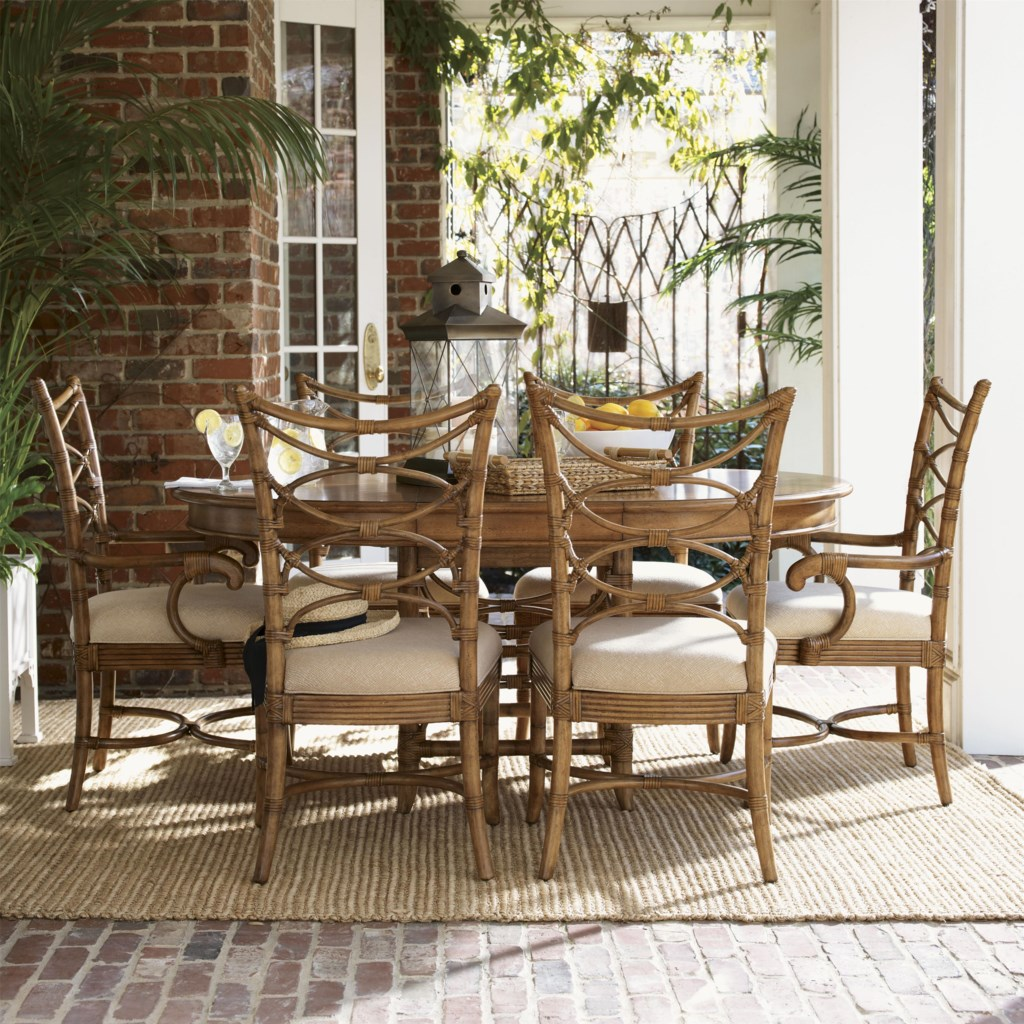 tommy bahama home beach house round coconut grove dining table shown with sanibel side and arm chairs