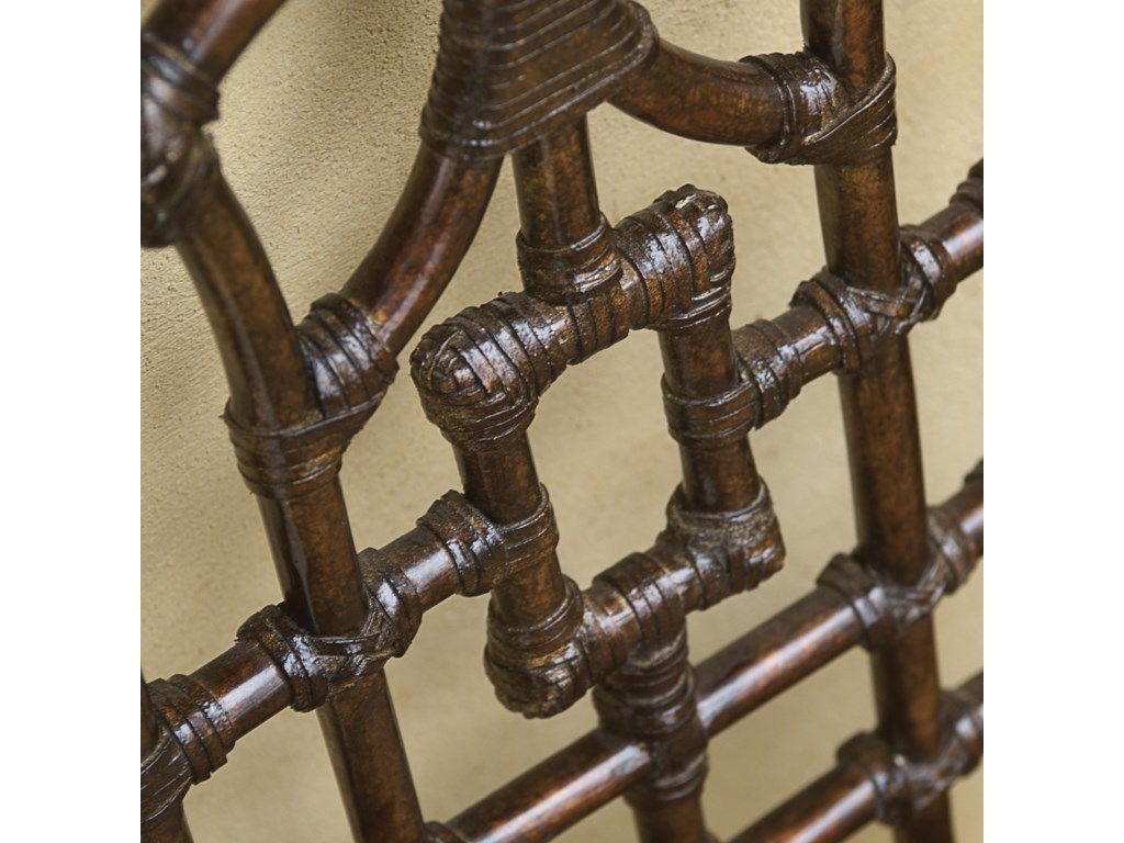 Rattan with Leather Wrapping Makes a Visually Intriguing Chair Back