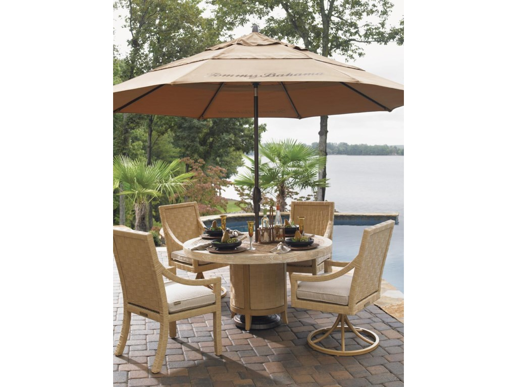 Shown with Round Table, Dining Arm Chair, and Umbrella