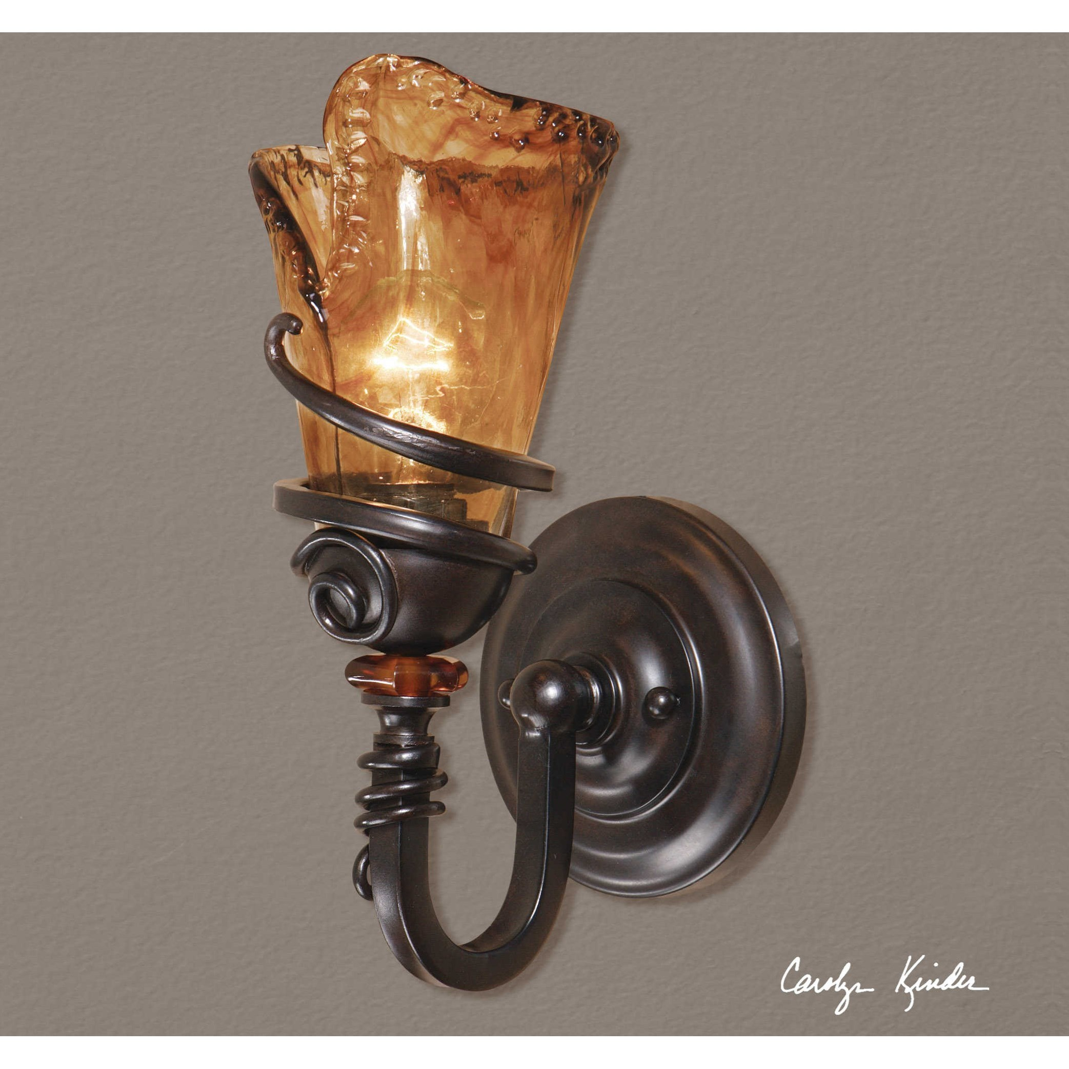 1 light vanity Rubbed Bronze sconce with amber hand blown glass*
