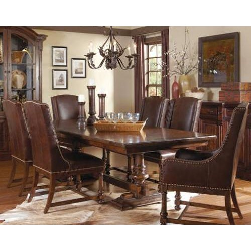 A r t furniture inc whiskey oak 7 piece trestle dining for Trestle dining room sets
