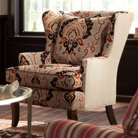 Traditional Upholstered Wing Chair with Track Arms and Exposed Wood Feet